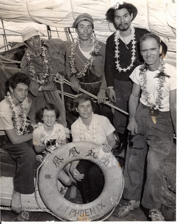 "Back row: Motosada (""Moto"") Fushima, Niichi (""Nick"") Mikami, Mitsugi (""Mickey"") Suemitsu. Front row: Ted, 16, Jessica (holding Mi-ke), 10, Barbara and Earle Reynolds"