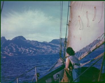 Jessica and ship's cat Mi-ke approaching Tahiti, 1955.